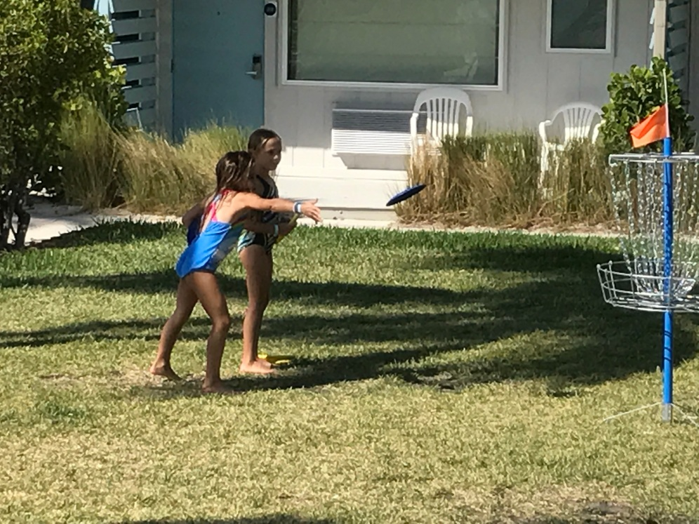 Maddy and Ella playing frisbee