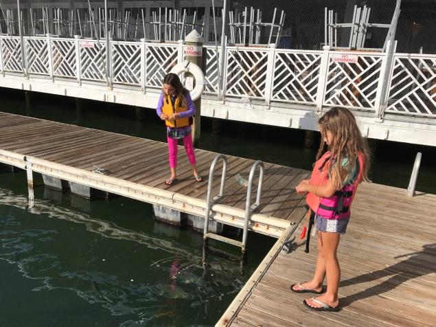 Girls feeding the fish