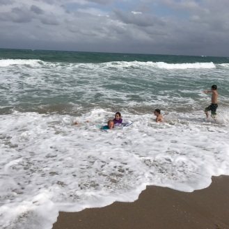 Molly and AnnaMay lost in the surf