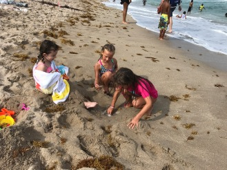 Maddy and Ella playing in the sand